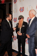 Andy Langer (L) interviews Billy Gibbons and Turk Pipkin during the 10th Annual Nobelity Project Feed The Peace Awards at the Four Seasons Hotel on February 15, 2015 in Austin, Texas.