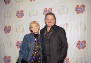 Dana Wheeler-Nicholson (L) and Alex Smith pose on the red carpet during the 10th Annual Nobelity Project Feed The Peace Awards at the Four Seasons Hotel on February 15, 2015 in Austin, Texas.