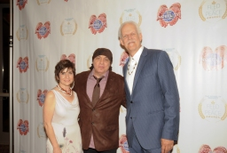 Christy Pipkin (L), Little Steven Van Zandt and Turk Pipkin pose on the red carpet during the 10th Annual Nobelity Project Feed The Peace Awards at the Four Seasons Hotel on February 15, 2015 in Austin, Texas.