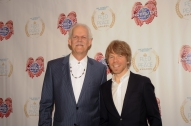 Turk Pipkin (L) and Warren Zanes pose on the red carpet during the 10th Annual Nobelity Project Feed The Peace Awards at the Four Seasons Hotel on February 15, 2015 in Austin, Texas.