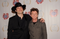 "Robert Rodriguez and Chris ""Whipper"" Layton pose on the red carpet during the 10th Annual Nobelity Project Feed The Peace Awards at the Four Seasons Hotel on February 15, 2015 in Austin, Texas."