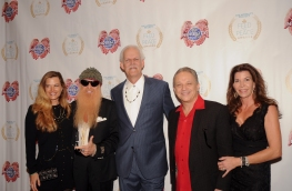 Gilligan Gibbons (L), Billy Gibbons, Turk Pipkin, Jimmie Vaughan and Robin Vaughan pose on the red carpet during the 10th Annual Nobelity Project Feed The Peace Awards at the Four Seasons Hotel on February 15, 2015 in Austin, Texas.