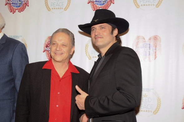 Jimmie Vaughan and Robert Rodriguez pose on the red carpet during the 10th Annual Nobelity Project Feed The Peace Awards at the Four Seasons Hotel on February 15, 2015 in Austin, Texas.